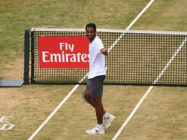 Ramkumar Ramanathan gestures after winning a point. Image courtesy: Twitter @TennisHalloFame