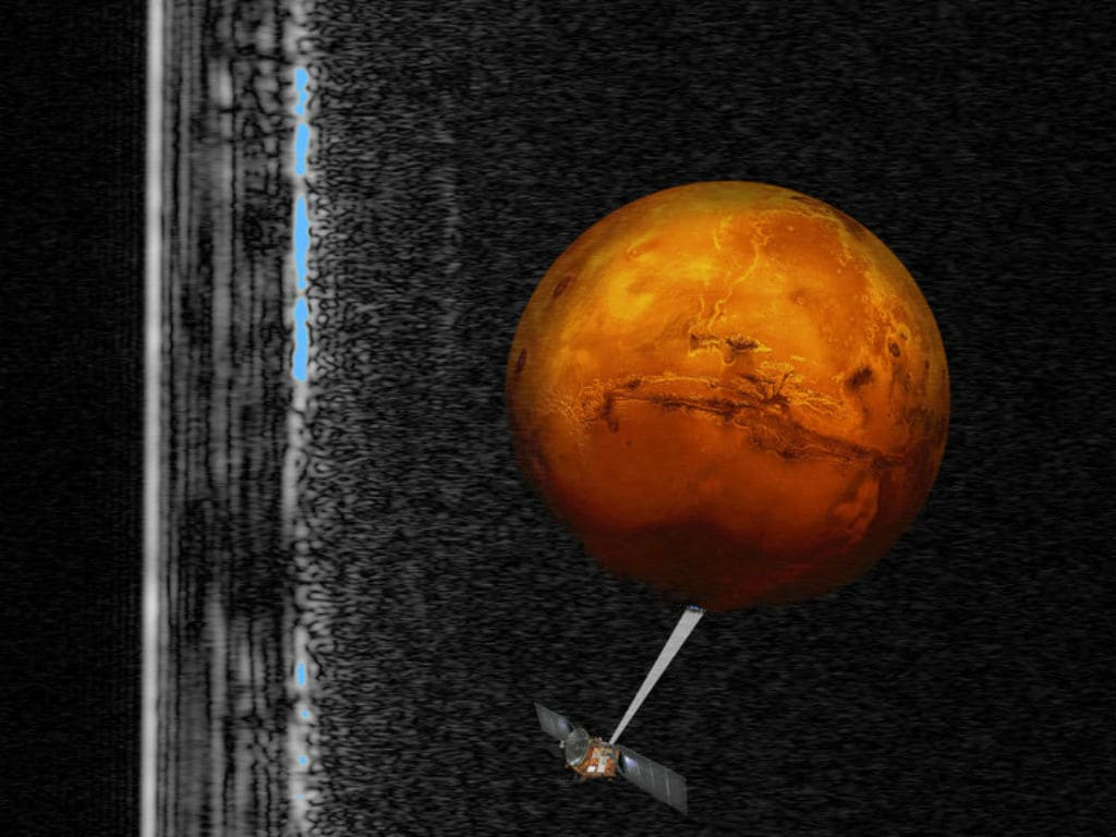 This artistic rendering shows the Mars Express Spacecraft probing Mars' south pole as radar signals appear at left. AP