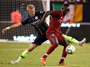 Liverpool forward Sadio Mane tries to control the ball as Manchester City midfielder Oleksandr Zinchenko defends during the second half of an International Champions Cup tournament match. AP