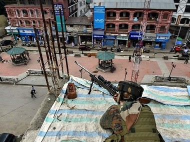 A CRPF personal guards Srinagar's historic Lal Chowk square. PTI