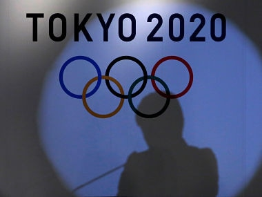 A shadow of of Tokyo governor Yuriko Koike is seen on the logo of Tokyo 2020 Olympic games during the Olympic and Paralympic flag-raising ceremony at Tokyo Metropolitan Government Building in Tokyo, Japan, September 21, 2016. REUTERS/Toru Hanai - S1BEUCOLXMAA