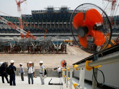 An electrical fan is placed at the construction site of the main venue for the Tokyo 2020 Olympics. Reuters