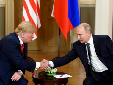 US president Donald Trump, left and Russian President Vladimir Putin shake hands during their meeting in the Presidential Palace in Helsinki, Monday. AP