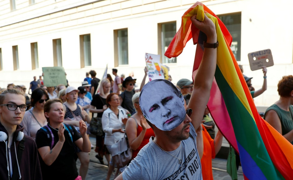 The protesters also stood together against the discrimination faced by members of the LGBT community in Russia. Reuters