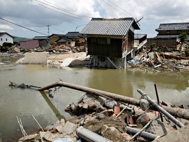 Submerged and destroyed houses in a flooded area in Mabi town in Kurashiki. Reuters