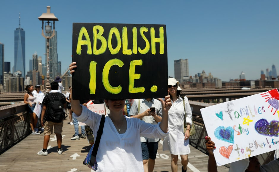 People marched across the Brooklyn Bridge and demanded that Immigration and Customs Enforcement (ICE) be abolished for its 'zero tolerance' policy towards immigrants. Reuters