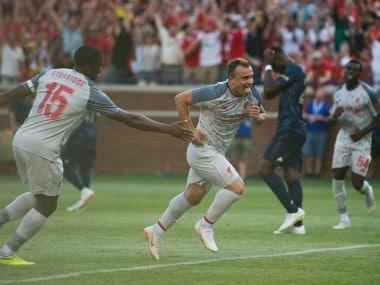 Liverpool's Xherdan Shaqiri celebrates scoring against Manchester United at Michigan Stadium. Reuters