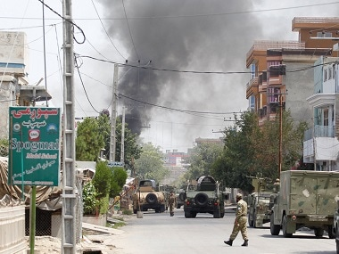 Smoke rises from an area where explosions and gunshots were heard, in Jalalabad city, Afghanistan. Reuters