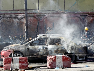 Afghan officials inspect the site of a blast in Jalalabad city on Sunday. Reuters