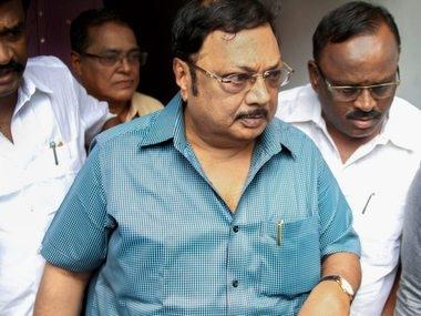 Alagiri visiting M Karunanidhi in Chennai. PTI