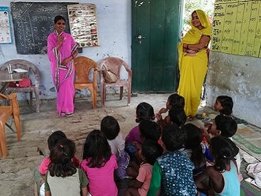 Anganwadi worker Madhubala, 47, at a pre-school education class at an anganwadi held in a primary school in Kuiya village, Farrukhabad. Image Courtesy: IndiaSpend/Swagata Yadavar