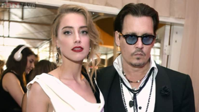 Johnny Depp with ex-wife Amber Heard. IBN