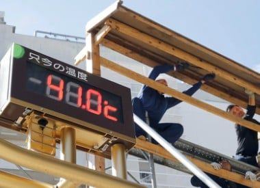 The thermometer reads 41.0 degrees Celsius (105.8 degrees Fahrenheit) in Kumagaya city, north of Tokyo. AP