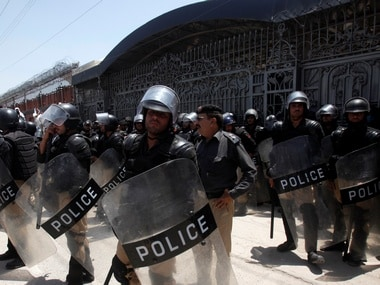Police officers stand guard during a demonstration against the constitutional amendment bill for the merger of Federally Administered Tribal Areas (FATA) with Khyber Pakhtunkhwa (KPK) province. Reuters