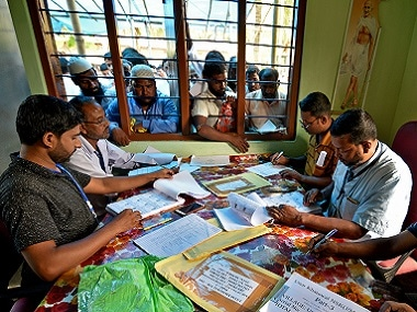 People wait to check their names on the National Register of Citizens (NRC) draft list at a centre in Assam's Nagaon district. Reuters