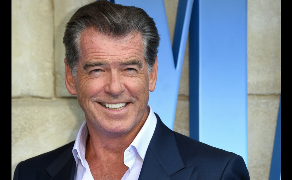 Pierce Brosnan poses on the red carpet upon arrival for the world premiere of the film Mamma Mia! Here We Go Again in London. AFP/Anthony Harvey