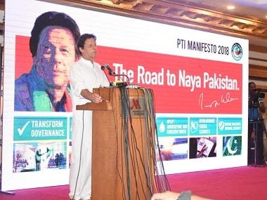Imran Khan unveiling PTI's manifesto. Image Courtesy: Twitter/PTIofficial