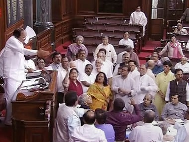 Rajya Sabha Chairman M Venkaiah Naidu tries to pacify the Opposition members who were protesting in the Well of the House. RSTV screengrab via PTI