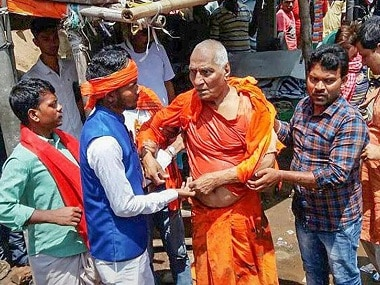 Swami Agnivesh after being beaten by a mob in Pakur, Jharkhand. PTI