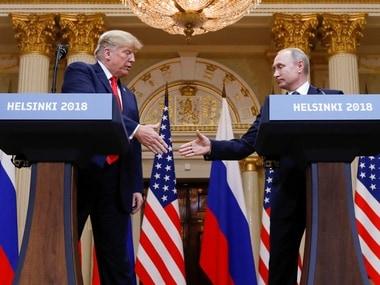 Donald Trump and Vladimir Putin in Helsinki. Reuters