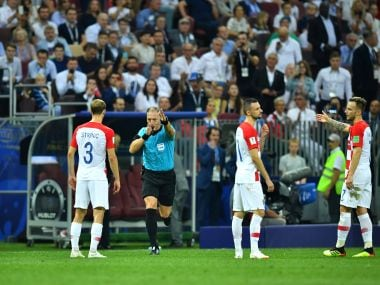 Referee Nestor Pitana calls for a penalty after a VAR review during the World Cup final. Reuters