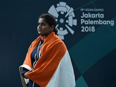 Gold medallist India's Rahi Jeevan Sarnobat observes her country's national anthem during the victory ceremony for the women's 25m pistol shooting final during the 2018 Asian Games in Palembang on August 22, 2018. / AFP PHOTO / Mohd RASFAN