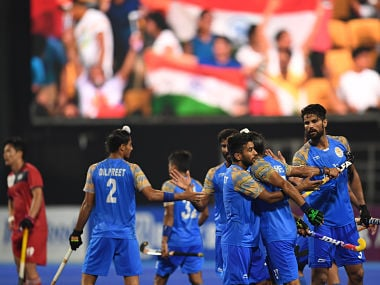 India's players celebrate after scoring a goal against South Korea during the men's hockey pool A match between India and South Korea at the 2018 Asian Games in Jakarta on August 26, 2018. / AFP PHOTO / AAMIR QURESHI