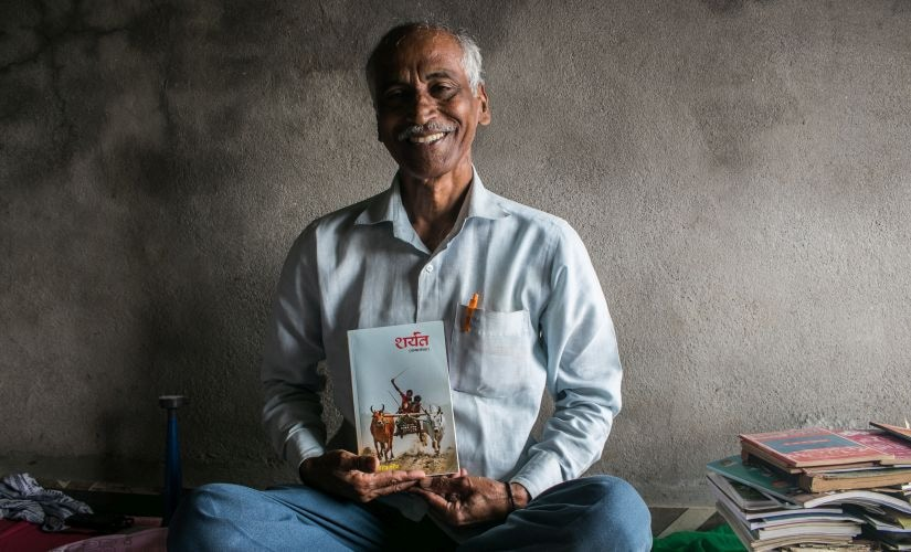 Khanderav Parit with his first published book, Sharayat