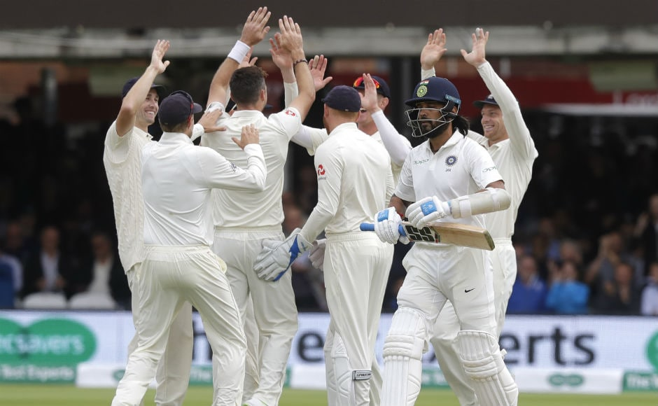 England players celebrate the dismissal of opening batsman Murali Vijay in the very first over of the Indian innings. AP