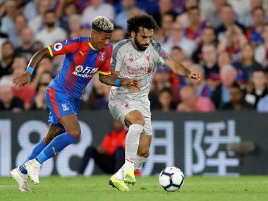Crystal Palace's Patrick van Aanholt, left, duels for the ball with Liverpool's Mohamed Salah. AP