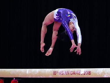 India's Dipa Karmakar performs on the balance beam during the women's apparatus gymnastics final competition at the 18th Asian Games in Jakarta, Indonesia, Friday, Aug. 24, 2018. (AP Photo/Dita Alangkara)