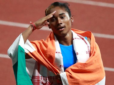India's Hima Das celebrates after her second place finish in the women's 400m final during the athletics competition at the 18th Asian Games at Gelora Bung Karno Stadium in Jakarta, Indonesia, Sunday, Aug. 26, 2018. (AP Photo/Dita Alangkara)