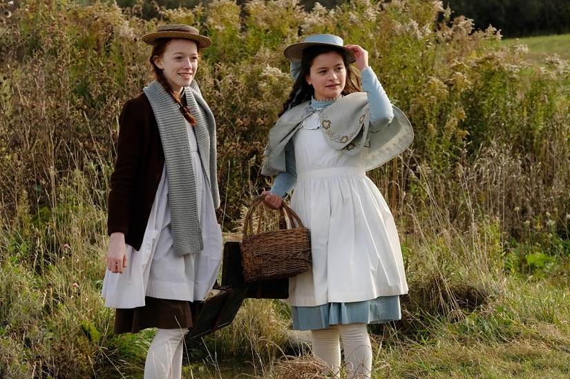 Amybeth McNulty as Anne Shirley and Dalila Bela as Diana Barry in Anne with an E. Netflix
