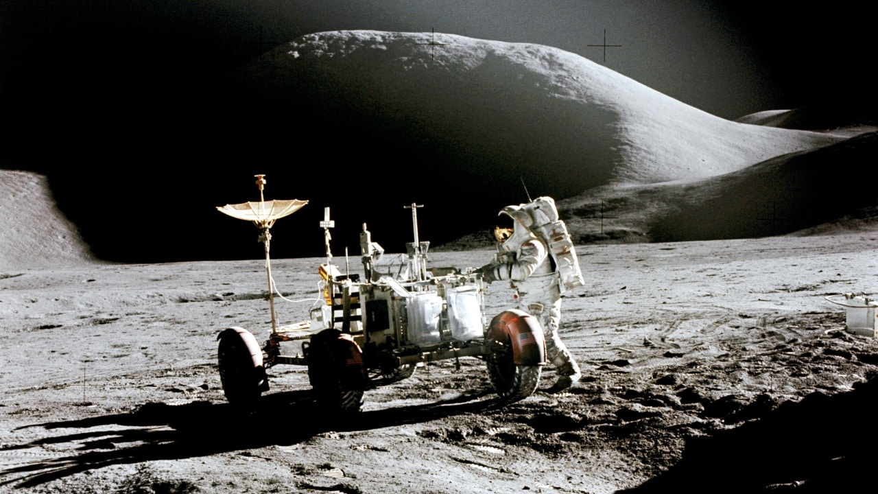 James Irwin works at the Lunar Roving Vehicle during the first Apollo 15 moonwalk. Mount Hadley is in the background. Image courtesy: NASA