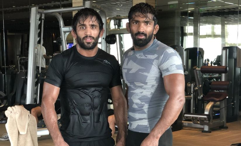 Friend, philosopher, guide, bhai, Yogeshwar Dutt's role in Bajrang's life is in line with the finest teacher-disciple tradition of Indian akhadas. Image courtesy: Twitter/ @BajrangPunia