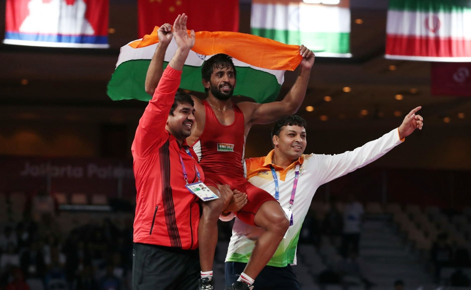 India's BajrangPunia reacts after winning the Wrestling Men's Freestyle 65 kg final against Japan's Daichi Takatani. AFP