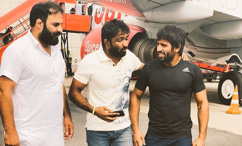 Bajrang with his mentor Yogeshwar Dutt upon returning from his gold-winning performance from Yasar Dogu International in Istanbul, Turkey last month. Image credit: Twitter/ @BajrangPunia