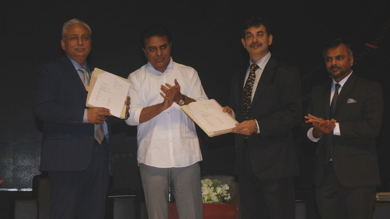 CP Gurnani, CEO & MD of Tech Mahindra (left); IT Minister KT Rama Rao (center) and Jayesh Ranjan (right) exchange the MoU.