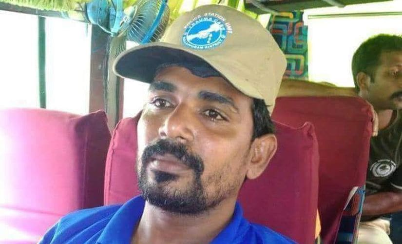 KP Jaisal, who leaned into floodwaters for an old woman, is no NDRF personnel. He is a fisherman from Tanur. Firstpost/Naveen Nair