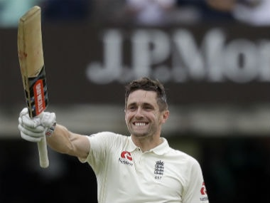 Chris Woakes raises his bat after bringing up his maiden Test ton. AP