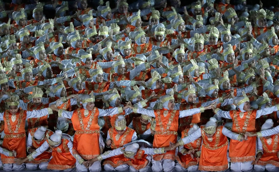 Dancers perform the traditional Indonesian dance form called Saman. AP