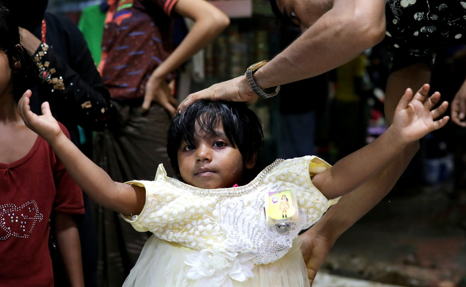 A Rohingya refugee girl tries on a new dress at a shop to celebrate Eid in the Kutupaloong refugee camp in Bangladesh's Cox's Bazar. Eid al-Adha, also known as the 'Festival of Sacrifice', falls on the tenth day of Dhu al-Hijjah and is celebrated with great enthusiasm by Muslims the world over. Reuters/ Mohammad Ponir Hossain