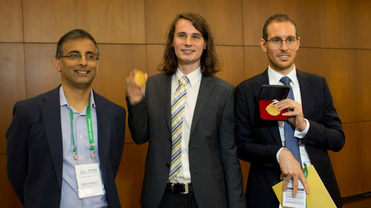 Italy's Alessio Figalli, right, Germany's Peter Scholze, center, and Akshay Venkatesh pose for a photo during the 2018 International Congress of Mathematicians in Rio de Janeiro. AP