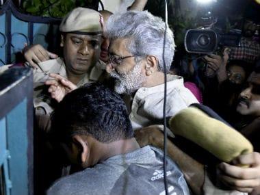 Gautam Navlakha being taken into police custody. PTI