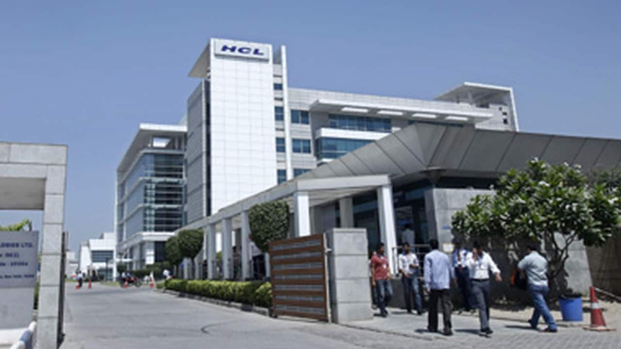 People walk in front of the HCL Technologies Ltd office at Noida. Reuters