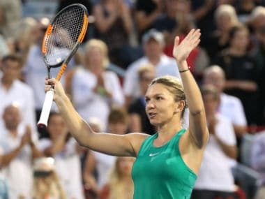 Simona Halep of Romania waves to the crowd after her win against Caroline Garcia of France. Reuters