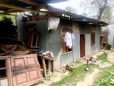 The woman's family lived in a tin shed for four years after their home was damaged in the 2014 floods. Firstpost/Sameer Yasir