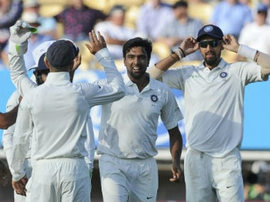 Ravichandran Ashwin celebrates with teammates after dismissing Alastair Cook at the stroke of stumps on Day 2. AP