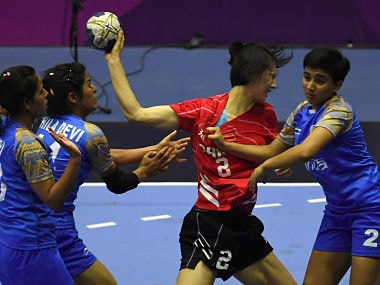Lin Yanqun of China attempts a shot on goal as India's Nidhi Sharma defends during the women's handball preliminary Group A match between India and China at the 2018 Asian Games in Jakarta. AFP
