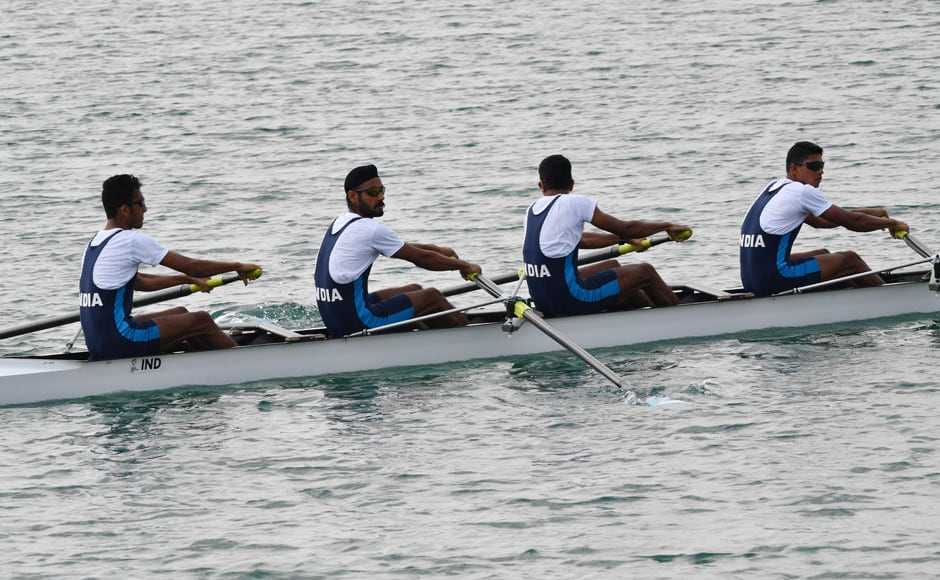 The Indian team, comprising of Sawarn Singh, Dattu Bhokanal, Om Prakash and Sukhmeet Singh won gold in men's quadruple sculls team event. AFP
